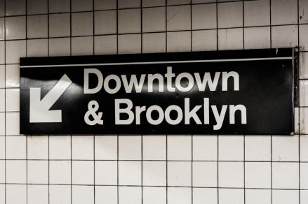 Downtown & Brooklyn sign in a subway station in Manhattan, New Y